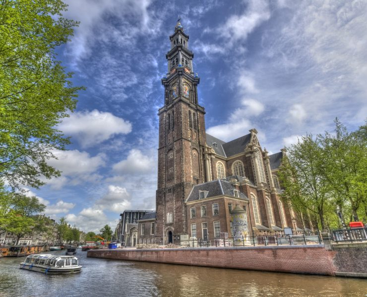 """""""The Westerkerk church and a tourboat in Amsterdam, Holland"""""""