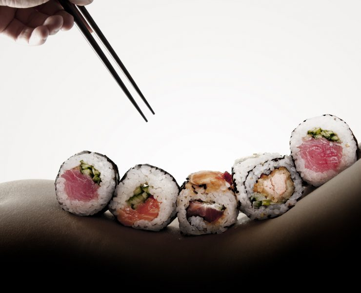 Body sushi - rolls on a naked woman